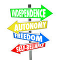 Independence road sign arrows autonomy freedom self reliance the words and on four pointing and directing you to a life of liberty Stock Image