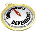 Independence vs dependence compass pointing way direction and words on a gold you to the toward self reliance instead of relying Royalty Free Stock Photo