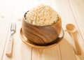 India cooked organic basmati brown rice in wooden bowl on dining table Royalty Free Stock Images