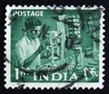 India postage stamp shows man working in a factory, series, circa 1954 Royalty Free Stock Photo