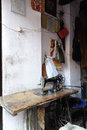 India tailors foot powered sewing machine a glimpse inside an indian tailor s shop a typical scene all over a lone in a tiny room Royalty Free Stock Photos