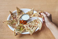 Indian aloo paratha woman holding traditional in restaurant Stock Photo