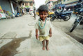 Indian baby walking down the street Royalty Free Stock Photo