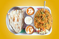 Indian biryani, butter naan with spicy curry Stock Photography