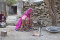 Indian blacksmith woman udaipur india january working on road making tradional tools for agriculture Royalty Free Stock Photos