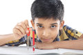 Indian boy with drawing note and pencil Royalty Free Stock Photo