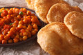 Indian bread puri and chana masala macro. Horizontal Royalty Free Stock Photo