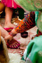 Indian bride doing marriage rituals colored foot fingure their mandap puja Royalty Free Stock Photography