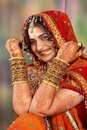 Indian bride in her wedding dress showing bangles Royalty Free Stock Photo
