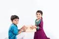 Indian brother and sister celebrating rakshabandhan or rakhi festival
