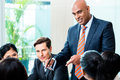 Indian Business man leading team meeting Royalty Free Stock Photo