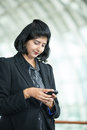 Indian business woman using mobile phone. Royalty Free Stock Photos