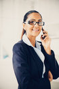 Indian business woman using mobile phone happy young Stock Photography