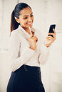 Indian business woman using mobile phone young happy Royalty Free Stock Photo