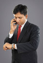 Indian Businessman with Cellphone Royalty Free Stock Photo