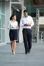 Indian Businessman & woman walking. Stock Photography
