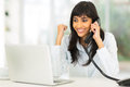 Indian businesswoman exciting news happy receiving over the phone Royalty Free Stock Image