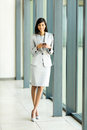 Indian businesswoman smart phone happy using in modern office Stock Photography
