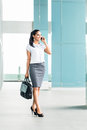 Indian Businesswoman Using Pho...