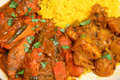 Indian chicken curry meal with rice and potato jalfrezi bombay aloo pilau Royalty Free Stock Images