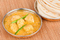 Indian chicken curry with parotta served bread in authentic copper utensils green chilli used as garnish Royalty Free Stock Images