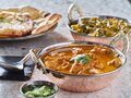 Indian chicken tikka masala curry and saag paneer curries on table top Royalty Free Stock Photo