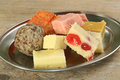 Indian confectionary selection of delicious sweets on a metal dish Royalty Free Stock Photography