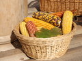 Indian corn corncobs in a basket stock photos fall composition decorated with maple leaves thanksgiving day photo Stock Photography