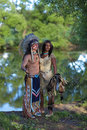 Indian couple chief with a young on the banks of the river Stock Photography