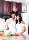 Indian couple in kitchen Stock Photos