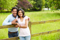 Indian couple walking in countryside daylight looking to camera smiling Stock Photo