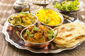 Indian cuisine as closeup on a silver tray Stock Images