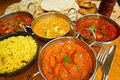 Indian cuisine buffet selection of food with pilau rice naan bread poppadoms and samosas a popular choice for eating out in Stock Image