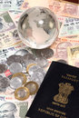 Indian currency with globe and passport closeup of Royalty Free Stock Photo
