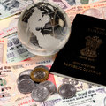 Indian currency with passport and gold notes coins Stock Photos