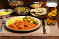 Indian curry dinner meal chicken with beer Stock Images