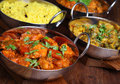 Indian curry dishes chicken jalfrezi with saag aloo and rice shallow dof focus on nearest Stock Image