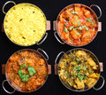 Indian curry food selection in dishes of chicken and vegetable curries with rice Royalty Free Stock Photography