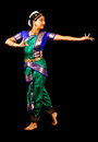 Indian dancer young woman in traditional sari dancing classical dance bharatanatyam on a black background Royalty Free Stock Photography