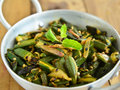 Indian dish bhindi masala okra with onions Stock Photos