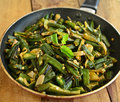 Indian dish bhindi masala okra with onions Royalty Free Stock Photo