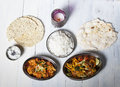 Indian dishes with rice on wood Royalty Free Stock Photo