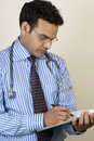 Indian doctor writing  prescription Stock Photography