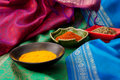 Indian fabric and spices Royalty Free Stock Photo