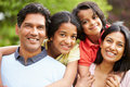 Indian family walking in countryside close up of smiling to camera Stock Image