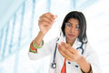 Indian female scientific researcher an holding at a liquid solution in a lab Royalty Free Stock Photography