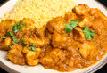 Indian food chicken curry meal with lentils served with bombay aloo potato and pilau rice Stock Photography