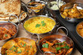 Indian food curry banquet selection curries bread rice and pickles Stock Images