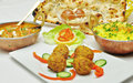 Indian food meat balls spicy chicken yellow rice and gulab jamun Stock Images