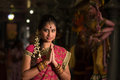 Indian girl praying young in traditional sari dress in a hindu temple Stock Image
